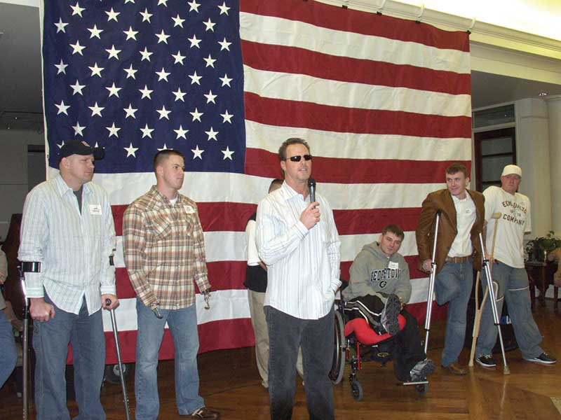 Jim McMahon with wounded vets